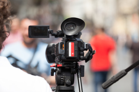 filming: Filming an event with a video camera