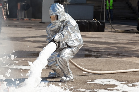 Firemen spray firefighting foam 免版税图像 - 39790287