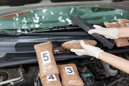 smuggling: Drug smuggled in a car engine compartment. Drug stash spot.