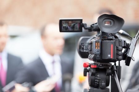 live event: Filming an media event with a video camera Stock Photo