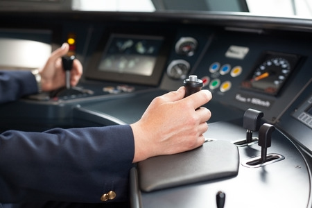 train engine: Railroad engineer. Train driver at the workplace. Stock Photo