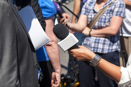 microphone: Broadcast journalism. Man on the street interview.