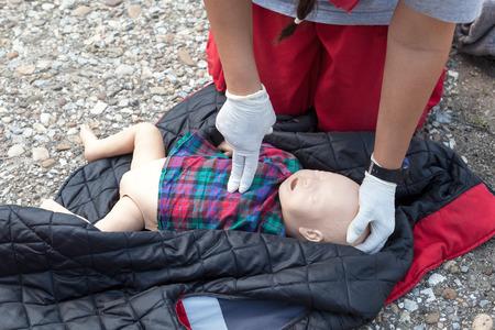 cpr: Child dummy cardiac massage. Cardiopulmonary resuscitation CPR. Stock Photo
