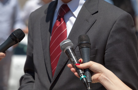 broadcast: Journalists making interview with businessperson or politician Stock Photo