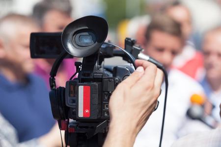 video camera: News conference. Video camera.
