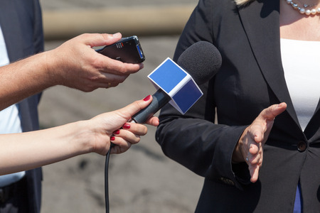 Journalists making interview with business woman