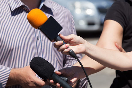 public: Media interview. Microphone. Stock Photo