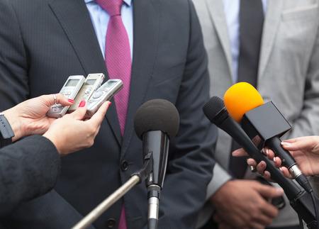 spokesman: Spokesman. News conference. Media interview. Microphones.