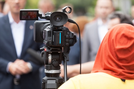 live action: Filming an event with a video camera
