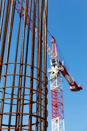 reinforcement: Construction site. Steel reinforcement. Building crane.