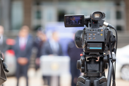 broadcast: News conference. Filming an event with a video camera. Stock Photo