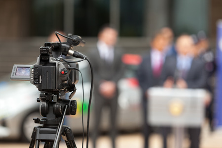 camera: News conference. Filming an event with a video camera. Stock Photo
