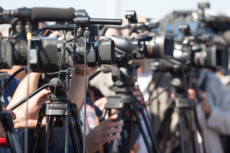 the news: News conference. Filming an event with a video camera. Stock Photo