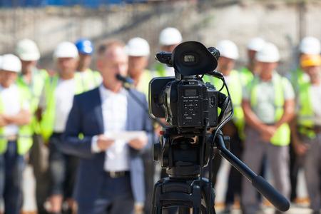 termine: Die Dreharbeiten eine Veranstaltung mit einer Videokamera Lizenzfreie Bilder