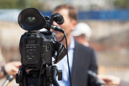spokesman: Filming an event with a video camera