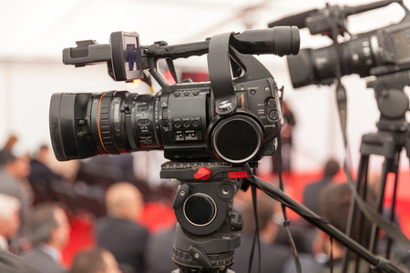 camera operator: Covering an event with a video camera Stock Photo