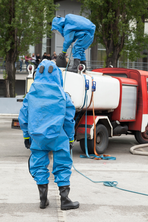 Simulation of a chemical spill after road accident Stock Photo