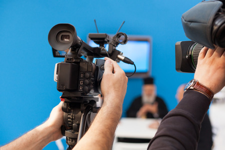 entertainment equipment: Filming an event with a video camera