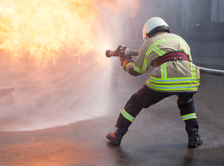 Firefighter in action Standard-Bild