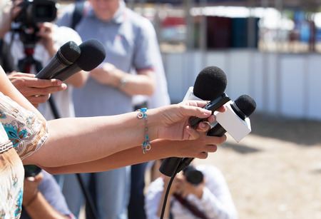 mics: News conference. Media interview.