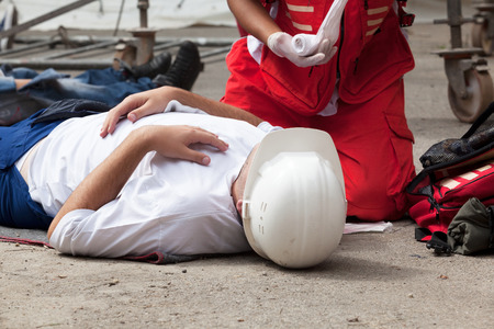 work safety: Work accident. First aid training.