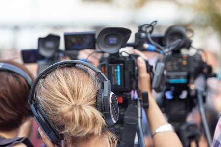 live action: News conference. Filming an event with a video camera. Stock Photo