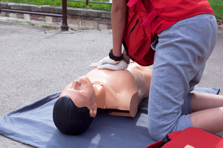 chest compression: First aid. Cardiac massage. Stock Photo