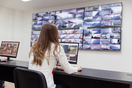 security room: Security system operator Stock Photo
