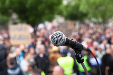 nonviolent: Public demonstration. Protest. Microphone.
