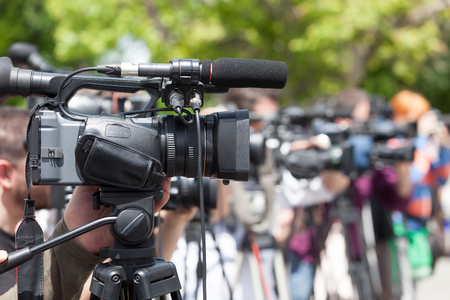 filming: Filming an event with a video camera. News conference. Stock Photo