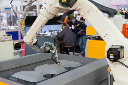 Welding robot arm Standard-Bild