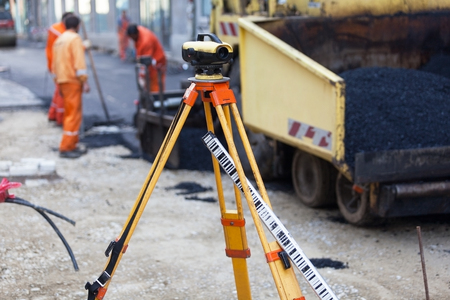 land surveying: Workers asphalting the street