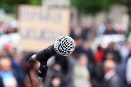 Protest. Public demonstration. Microphone. Stock Photo
