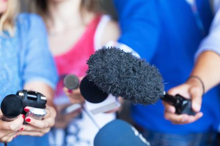 Media interview. Microphones.