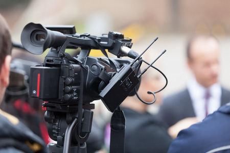 media event: Filming an media event with a video camera. Press conference. Stock Photo
