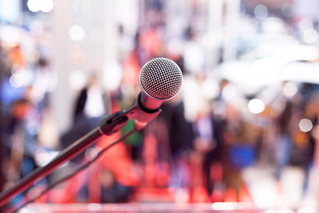information equipment: Microphone in focus against blurred audience