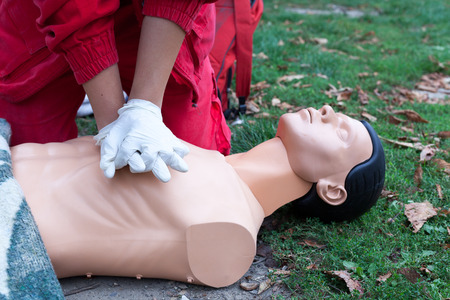 Paramedic demonstrate Cardiopulmonary resuscitation - CPR on dummy.