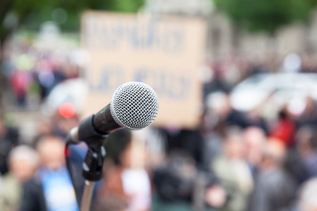 nonviolent: Protest. Public demonstration. Microphone. Stock Photo