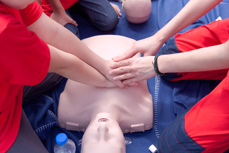 chest compression: First aid course Stock Photo
