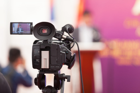 statesman: Filming an media event with a video camera Stock Photo