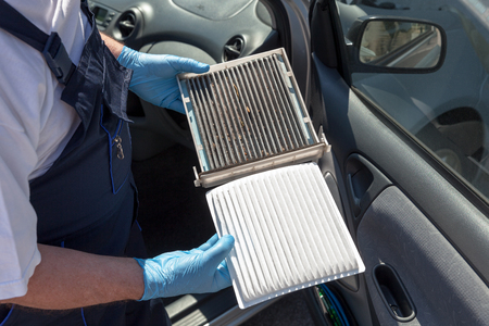 Clean and dirty cabin air filter for car Foto de archivo