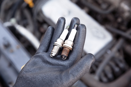 sparking plug: Spark plug, old and new Stock Photo