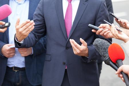 Press interview. Hand gesture. Businessman or politician.