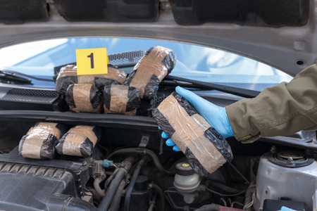 Drug smuggling in a car engine compartment Stock Photo