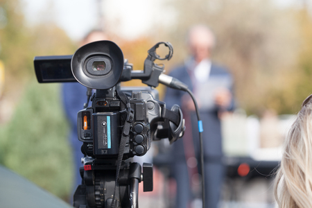 News conference. Shooting media event with a video camera. Stock Photo