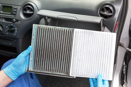 Old and new cabin pollen air filter for a car