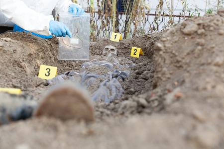 Exhumation: Forensic science specialist at work Zdjęcie Seryjne