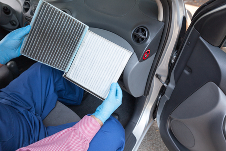 Clean and dirty cabin pollen air filter for a car 写真素材