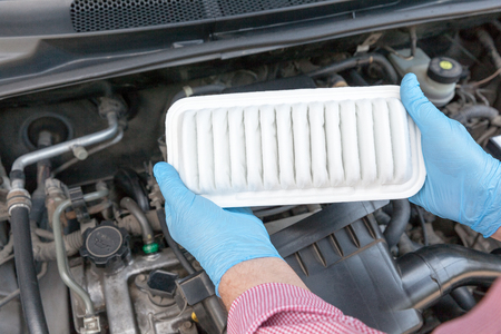Installing new car engine air filter