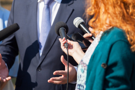 Journalists making media interview with businessman or politician
